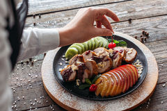 Chief decorated baked veal with fresh cherry Royalty Free Stock Images