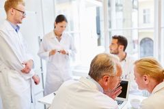 Chief doctor and team in meeting. In hospital royalty free stock photography