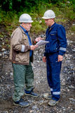 Chief Engineer and drilling Head discussing plans Stock Photography
