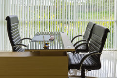Chief executive desk. Chief executive or manager office with desk and armchairs royalty free stock photography