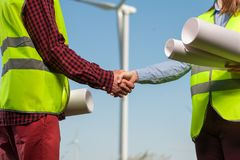 Concept of engineers and windmills royalty free stock photos
