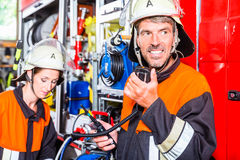 Chief fire fighter  checking radio set Stock Photo