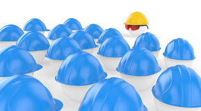 The chief in a helmet faces to workers Stock Photo