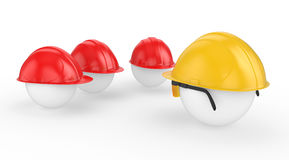 The chief in a helmet faces to workers Stock Images