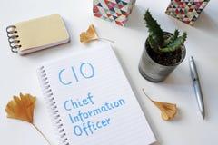 Chief information officer di CIO scritto in taccuino fotografia stock libera da diritti