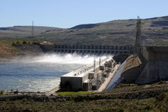 Chief Joseph Dam. Hydroelectric Chief Joseph Dam gates open with water gushing stock photo