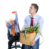 Chief kicks out the dismissed worker Stock Image