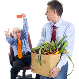 Chief kicks out the dismissed worker Royalty Free Stock Photo