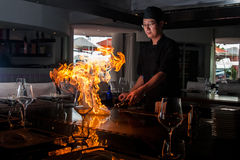 Chief make fire on Teppanyaki grill Stock Photo