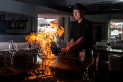 Chief make fire on Teppanyaki grill. Japanese restaurant chief make fire on Teppanyaki grill, Costa Adeje, september 2014 Stock Photo
