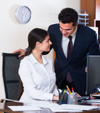 Chief manager and young employee Royalty Free Stock Photography