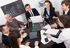 Chief with officials preparing contract Royalty Free Stock Photo