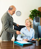 Chief paying to mature assistant an yearly bonus Royalty Free Stock Photography