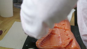 Chief peeling fish stock video footage