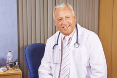 Chief physician in his hospital office. Senior chief physician smiling in his hospital office Royalty Free Stock Photos