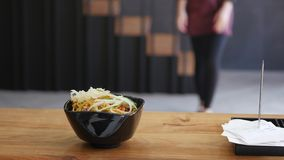 The chief puts noodles with chicken and vegetables in Japanese style stock footage