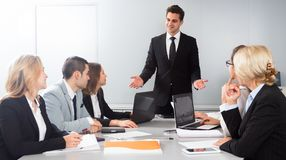 Chief speech at meeting room. Male chief speech at meeting room royalty free stock photo