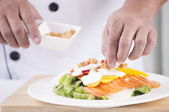 Chief sprinkle biscuits on Salad Royalty Free Stock Photo