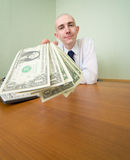 Chief stretching to us a pack of dollars Royalty Free Stock Images