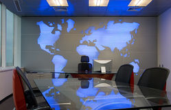 Chiefs cabinet. With world map behind Royalty Free Stock Photos