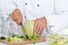 Chiefs hands cutting cabbage Royalty Free Stock Photos