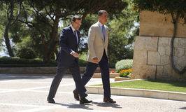 Chiefs 020. Spains king Felipe (R) and prime minister Mariano Rajoy seen during a meeting in the Marivent palace on the island of Majorca, Spain Stock Images