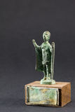 Chieftain praying with cloak and stick, bronze figurine royalty free stock images