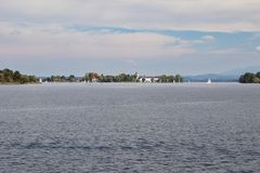 Chiemsee with Frauenchiemsee island in a distance Royalty Free Stock Photos