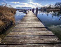 Chiemsee lake. Old wooden jetty at the chiemsee lake in bavaria Royalty Free Stock Photo