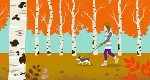 Chien marchant en nature d'automne Photographie stock libre de droits