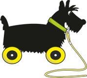 Chien terrier écossais de chiot - jouet sur des roues Image libre de droits