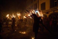 Chienbäse - Men with burning broom sticks Royalty Free Stock Images