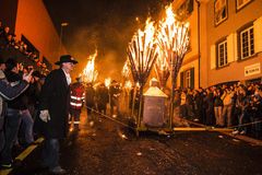 Chienbase Fastnach parade and attendees in Liestal, Switzerland. Liestal, Switzerland, February 22, 2015: Chienbase parade and attending people in city of Stock Image
