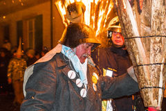 Chienbase Fastnach parade and attendees in Liestal, Switzerland. Liestal, Switzerland, February 22, 2015: Chienbase parade and attending people in city of Royalty Free Stock Image