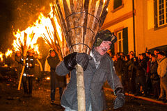 Chienbase Fastnach parade and attendees in Liestal, Switzerland. Liestal, Switzerland, February 22, 2015: Chienbase parade and attending people in city of Royalty Free Stock Photos