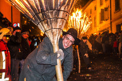 Chienbase Fastnach parade and attendees in Liestal, Switzerland. Liestal, Switzerland, February 22, 2015: Chienbase parade and attending people in city of Stock Photography