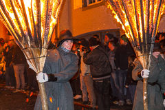 Chienbase Fastnach parade and attendees in Liestal, Switzerland. Liestal, Switzerland, February 22, 2015: Chienbase parade and attending people in city of Royalty Free Stock Images