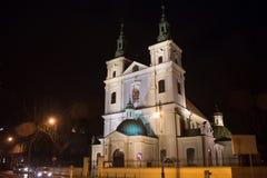Chiesa collegiale della st Florian nella parte storica di Cracovia alla notte Immagini Stock
