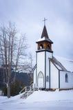 Chiesa del paese in inverno Fotografie Stock Libere da Diritti