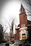 Chiesa della città nell'inverno Fotografie Stock