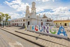 Chiesa di Merced ed insegna Latacunga Ecuador Fotografie Stock Libere da Diritti
