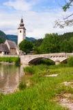 Chiesa di St John il battista, lago Bohinj, Slovenia Fotografia Stock