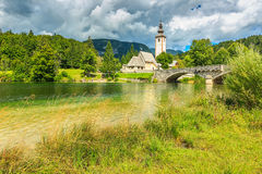 Chiesa di St John il battista, lago Bohinj, Slovenia, Europa fotografia stock