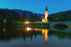 Chiesa di St John il battista nel lago Bohinj Fotografie Stock