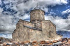 Chiesa di trinità di Gergeti Fotografie Stock