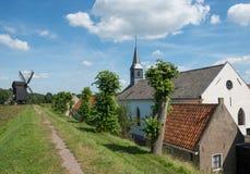 Chiesa e mulino a vento Immagini Stock Libere da Diritti