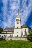 Chiesa gotica neo di San Martino nel lago sanguinato Fotografia Stock Libera da Diritti