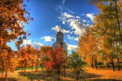 Chiesa nella foresta di autunno Immagini Stock Libere da Diritti