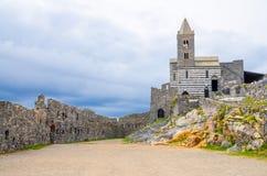 Chiesa San Pietro catholic church, Lord Byron Parque Natural park and old ancient stone walls of Portovenere royalty free stock photos