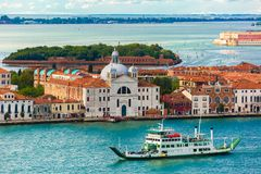 Chiesa Santa Maria delle Zitelle in Venice, Italy. View from Campanile di San Marco to Chiesa Santa Maria delle Zitelle and Vaporetto at summer morning on Royalty Free Stock Photography